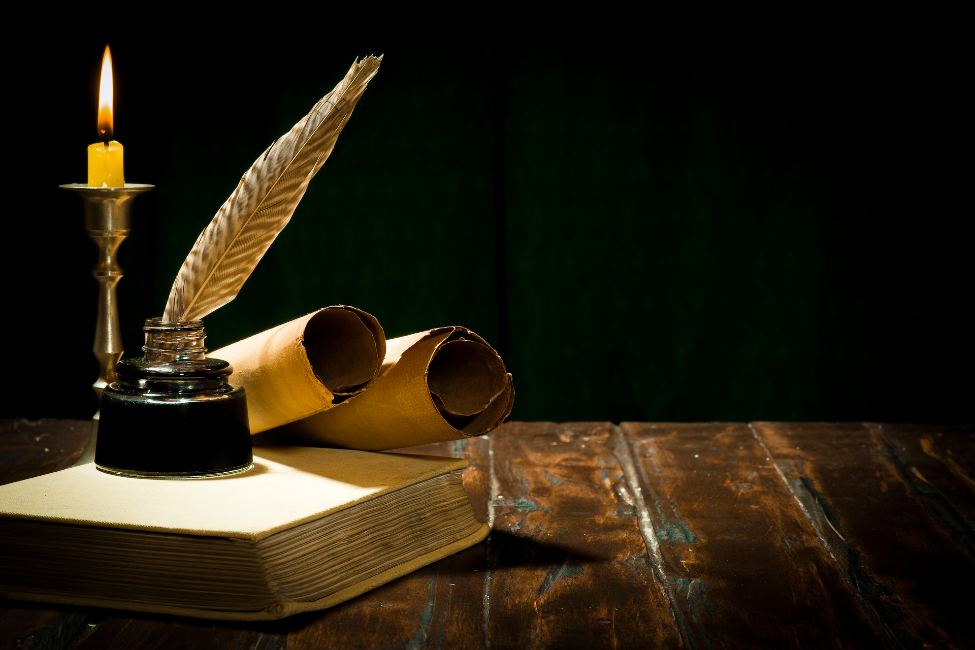 stock-photo-education-and-writing-concept-pen-in-ink-bottle-and-candlestick-with-candle-on-wooden-table-on